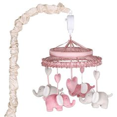 The Peanut Shell Bella Musical Mobile features adorable pink and grey elephants on ribbons. It plays a gentle lullaby to soothe your baby girl to sleep. Place at baby's feet for visual, auditory and motor development. Coordinates with the Bella nursery collection, sold separately. No batteries required.<br><br>The Peanut Shell Bella Elephant Musical Mobile Features:<br><ul><li>No batteries required</li><br><li>Spot Clean</li>...