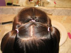 Knot and 2 small pony tails  Avery 'do. This wasn't hard & looked cute! I ended up doing another ponytail in the back because Avery wanted it all up & that worked with this too. It stayed in all day.