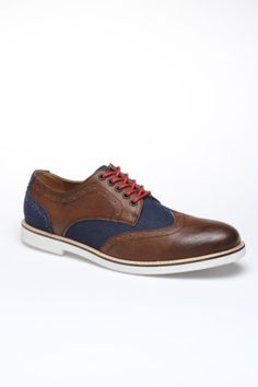 Hillsboro Vincent Wing Tip. I seen a few shoes similar to these with the brown and blue, but these ones pull it off the best. Not sure about the distressing on the canvas heels tho.