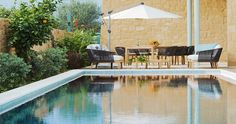 """Each Villa has its own private overflow swimming pool that can be entered by its yacht style wooden deck. It's your next vacation house during your vacation in our """"Villa Orangia"""" - Crete, Greece. You can rent it !"""