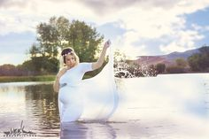 Amazing maternity shoot in water with a long white dress. Gotta see these images!!!