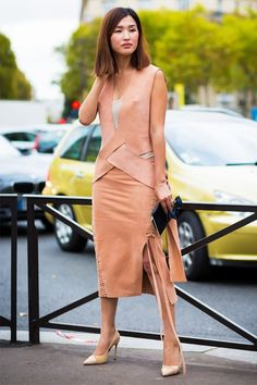 Elongate your stature by trying out a monochromatic outfit with a midi skirt accented with a slit