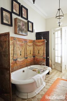 """""""Use and enjoy your antiques and unique finds, especially in a utilitarian room like the bathroom. Keep cotton swabs in a hand-painted tin or sea-grass box; hang art that can survive a splash."""" —Bunny Williams   - HouseBeautiful.com"""