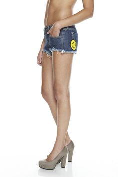Blue denim cutoff short with patch detailing. Pair with a colorful top for a playful day look. $79