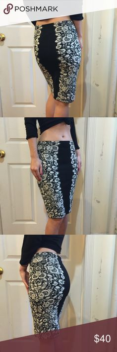 BCBGMAXAZRIA Black White Floral Bandage Skirt In new condition, by BCBGMaxAzria black and white bandage skirt that has a flower print along the sides, with black on the inside body. Size Medium and fits a small- stretchy and super trendy :) this won't last long! BCBGMaxAzria Skirts Pencil