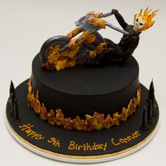 Ghost Rider & Hell Cycle - Modelling chocolate Ghost Rider and (part of) Hell Cycle.  Chocolate fudge cake with dark chocolate ganache, covered in fondant with fondant flames