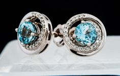 Pale blue like the summer sky, each of these aquamarine studs features a .40 ct aquamarine with a swirl of 22 diamonds around it. All set in 14k white gold.