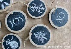 These are made from slices of a log - then painted with blackboard paint and decorated with chalk/white paint. They would make very cute gift tags for presents too.