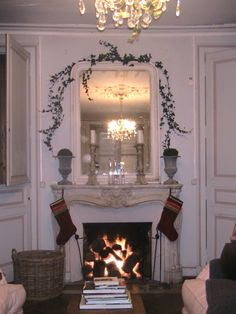 One of eight original fireplaces at Maison Numero Neuf.
