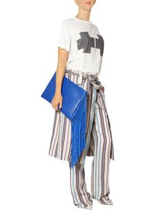 Most Wanted for summer: this oversized electric blue clutch with fringes.  CRAZY BLUE BAG - Designer: Laura Olaru EUR 75/ RON 250  Available at Band of Creators - Designers' Store and online here: http://www.bandofcreators.com/product-details/laura-olaru/bags/crazy-blue-bag