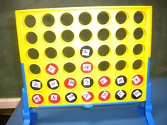 Adapted Connect 4 - Ideas to try:  spelling words, sorting letters into columns, sorting consonant and vowels, sorting capitals and lowercase letters.  If you don't want to tape the letters on, consider writing the letters on chips with a sharpie (black for red chips and silver for black chips).