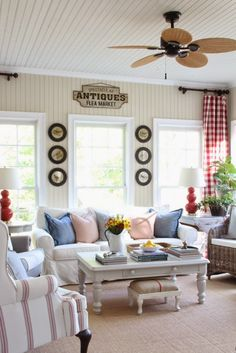 Savvy Southern Style: Spring In The Sun Room, Pottery Barn basic sofa, Pottery Barn Thatcher chair, Antique Farmhouse bird prints, beadboard, Pottery Barn pillows, H & M pillows, grain sacks, red buffalo checked curtains, Safeviah lamps, kooboo chairs, fiddleleaf fig, painted furniture