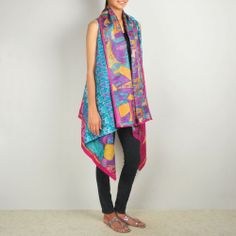 Blue-Multicolor Patterned Kantha Shrug Kantha sari shrugs are a unique variation on our sari shawls. Loose-fitting and free-size, they can be worn in a dozen ways and are an elegant, reversible and hands-free way of wearing our beautiful kantha fabric. Wear them loose; wear them wrapped around your body and tied with a brooch; wear them fastened with a belt. Shop no at: http://www.tadpolestore.com/house-of-wandering-silk #newdesigndaily #designgoodness #shrug #kantha #silk #unique #designer