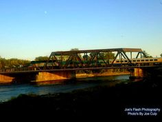 VIA Train crossing over the Moira river steel Trestle Belleville Ontario