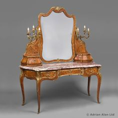 An Exceptional Gilt-Bronze Mounted Kingwood and Marquetry Dressing Table by Joseph-Emmanuel Zwiener. Stamped 'E. ZWIENER'. Forming part of an important and very rare bedroom suite, comprised of an armoire, a double bed, and a dressing table , all with fine marquetry inlay.