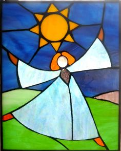 'Sunshine Angel' stained glass panel in a variety of different class types just for fun to bring a smile....https://www.facebook.com/pages/Rita-Readman-Art/270262966411327