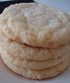 Pudding Sugar Cookies -- 1 c. butter softened, 1 c. vegetable oil, 1 cup sugar, 1 c. confectioners' sugar, 2 eggs, 1 tsp. vanilla, 1 package (3.4 oz) vanilla instant pudding mix, 4 c. all-purpose flour, 1 tsp. cream of tartar, 1 tsp. baking soda