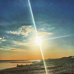 Laser beam sunset Bracklesham Bay by Lizzie Reakes