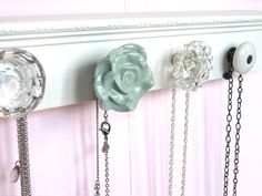 jewelry rack from miscellaneous knobs....possibly add ribbons and make into a hairclip holder?