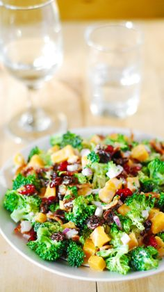 Broccoli salad with bacon, raisins, cranberries, and cheddar cheese: comfort food and it's gluten free!