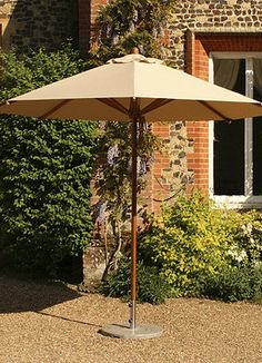 Relax in the shade on a hot day under the Levante Bamboo Umbrella.
