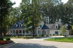 Country Style House Plan - 4 Beds 5.00 Baths 4445 Sq/Ft Plan #137-130 Exterior - Front Elevation