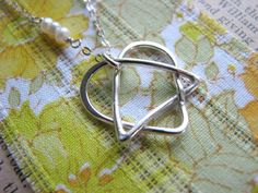 Celtic Adoption Triad Necklace - Sterling Silver  One corner represents the birth parents, another corner represents the adoptive parents, and the third corner represents the adoptee. All are surround by love.