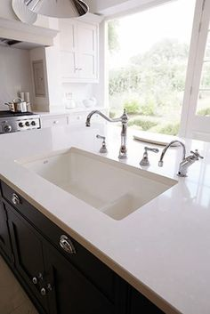 Love this double enamel sink, positioned just below the granite top.  Not sure what the tap is to the right. Useful?