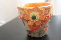 A little terracotta pot that I painted. Then I mod-podged on pieces of cut up scrapbook paper and emblished.