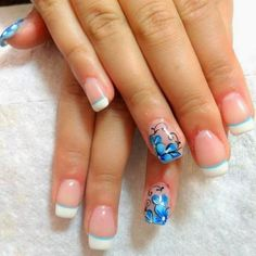 French manicure with a twist. White and blue tips. Floral design on nails. Blue nails.