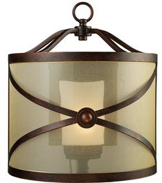Elk Lighting presents the Cumberland 1-Light Wall Sconce, featured in a Classic Bronze finish and complemented by a Transparent Glass, captures a distinguished style which enhances any space in the home