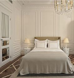 bedrooms-cream-beds-bedspreads-chandeliers-headboards-mirrors-table-lamps-wood-floors