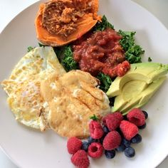 BREAKFAST – 2 EGGS, 1/2 SWEET POTATO WITH ALMOND BUTTER, KALE & SALSA, RASPBERRIES AND BLUEBERRIES & AVOCADO