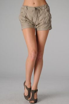 Esley> Shorts> 8100P Cargo Tunic Shorts These cargo tunic shorts have cuffed hem and pockets with ribbon tie at the waist 55%linen 45%rayon usfashionstreet.com