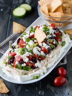7 Layered Greek Dip - Need an easy, flavorful appetizer for a crowd? Look no further than this Layered Greek Dip recipe. It's the veggie-packed, Mediterranean version of the popular 7 Layer Dip! Greek Appetizers, Appetizers For A Crowd, Appetizer Dips, Yummy Appetizers, Appetizer Recipes, Dinner Recipes, Greek Layer Dip, Greek Dip, Greek Salad