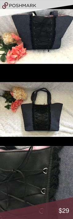 🌸 VICTORIA'S SECRET denim corset TOTE🌸 🌸 VICTORIA'S SECRET denim corset TOTE🌸 New with tags (1/2 of tag is ripped, still attached to bag) gorgeous denim CORSET lace up style TOTE! Black lace accent by corset lace up front. Beautiful silky pink interior. New condition 💗🌸 Victoria's Secret Bags Totes