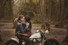 Sultry motorcycle engagement photos in the woods by Motiejus Photography