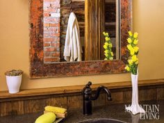 Log Cabin, Helena Montana  Nolte built the mirror for the cabin's only bathroom. Visible in the reflection, brick salvaged from the original structure's chimney surrounds the shower.