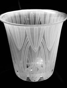 "Deco Lilies- Vintage ice bucket with tall lily blooms designed around the entire vase. 8.75"" tall x 9"" dia. opening"