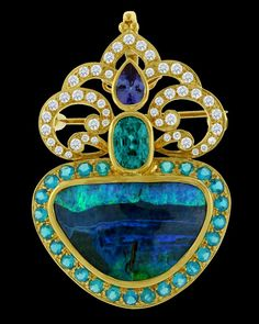 Paula Crevoshay Opal, Tanzanite, Apatite, Blue Zircon, and Diamond Pendant ~ This one of a kind pendant/brooch displays a center 22.30 carat Opal surrounded by 0.78 carats of Tanzanite, 1.99 carats of Apatite, 4.45 carats of Blue Zircon, and 1.16 carats of Diamond, creating a stunning look that is a feast for the eyes. Set in 18k yellow gold.