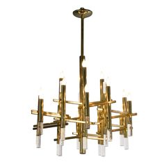 "Mystical Aligned Brass and Lucite Rod Chandelier  Italy  1970s  Eighteen light brass chandelier with 18 down lucite accents, by Sciolari, Italian 1970. Diameter 28"", height of fixture 24"". Rod can be cut to desired drop or length."