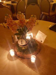 Custom wood slice, burlap runner, succulent, candles, hydrangea, mason jars centerpiece
