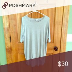 Brand new cream color Lularoe Irma Tunic Just purchased and washed according to directions only to find it is too big it's a great color that will go with just about anything LuLaRoe Tops Tunics