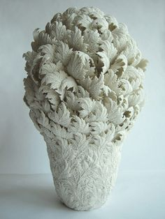 Hitomi Hosono, a London-based ceramic artist who creates botanical ceramic sculptures. All of Hosono's vessels are thrown on a wheel. The foliage is hand-carved and then attached.