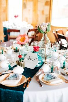 Gorgeous wedding table decor for a summer wedding with Mexican traditions. Love the turquoise contrasted with the gold and other bright colors. So classy yet fun! The roses and maracas are also a nice touch. Taken at THE SPRINGS Event Venue in Aubrey, TX. Book your free tour today!