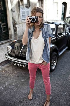 pink pants with white v neck and chambray