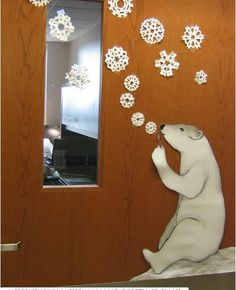 classroom decoration for winter - omg how cute! A polar bear blowing snowflakes instead of bubbles!