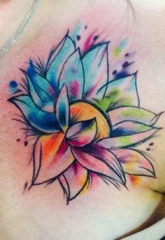 Watercolor lotus done by Nina Reed at Skin Deep studios in Longview, Tx