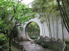 The Classical Gardens in Suzhou provide a strong sense of security and privacy. The gardens reflected the owners' characteristics and sometimes illustrated their ideal or ambitions. Normally, these gardens were built for their life after retirement. Therefore, these gardens are enclosed by high walls to isolate from the outside world. And this picture shows a threshold used frequently in classical gardens.    These arches limit people's view and the twisted path makes a sense of wandering.