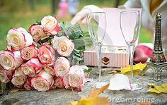 Sparkling wine and glasses in the fall park, composition for a romance picnic or anniversary.